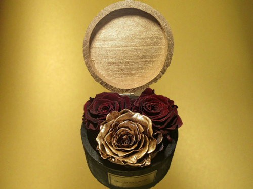 Wooden box with burgundy and gold roses